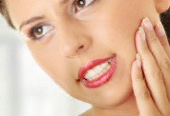 Повышенная чувствительность зубов, ее причины и лечение